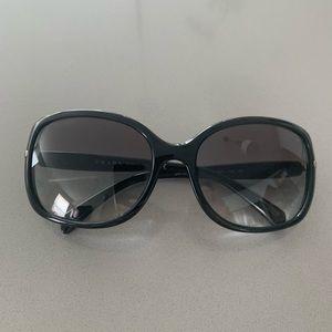 Very fashionable black Prada sunglasses